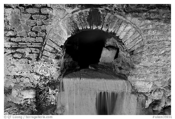 Roman-built brick channel overflow from the sacred spring. Bath, Somerset, England, United Kingdom (black and white)