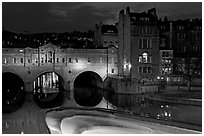 Pulteney Bridge and weir at night. Bath, Somerset, England, United Kingdom (black and white)