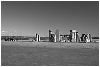 Large group of tourists looking at the megaliths, Stonehenge, Salisbury. England, United Kingdom (black and white)