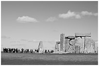 Large group of tourists looking at the standing stones, Stonehenge, Salisbury. England, United Kingdom (black and white)
