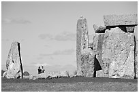 Couple looking at the standing stones, Stonehenge, Salisbury. England, United Kingdom (black and white)