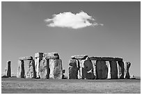 Stone circle and isolated cloud, Stonehenge, Salisbury. England, United Kingdom ( black and white)