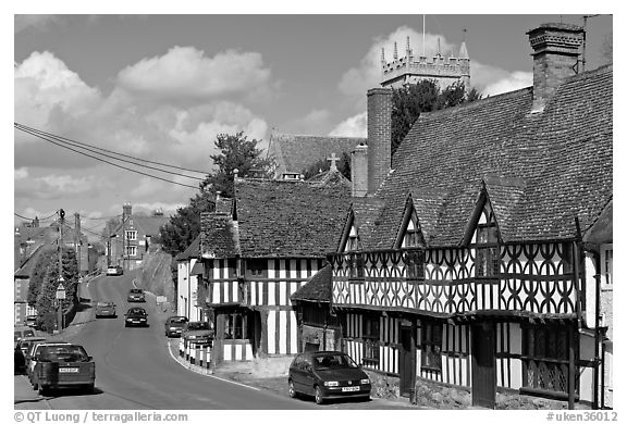 Village main street lined with half-timbered houses. Wiltshire, England, United Kingdom (black and white)