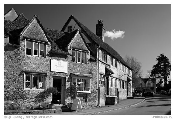 Street lined with stone houses, Lacock. Wiltshire, England, United Kingdom (black and white)