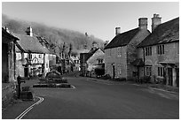 Main village street,  half timbered Court House, and Butter Cross, Castle Combe. Wiltshire, England, United Kingdom (black and white)