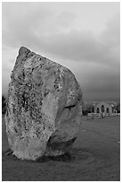Standing stone and chapel at dusk, Avebury, Wiltshire. England, United Kingdom ( black and white)