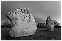 Large standing stones and brewing storm at dusk, Avebury, Wiltshire. England, United Kingdom ( black and white)