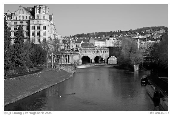 Avon River, Empire hotel, and Pulteney Bridge, morning. Bath, Somerset, England, United Kingdom (black and white)