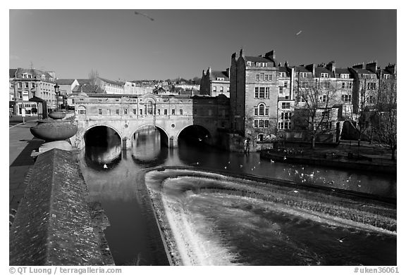 Weir on the Avon River and Pulteney Bridge. Bath, Somerset, England, United Kingdom (black and white)