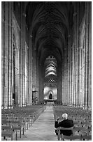 Man sitting in the Nave of the Canterbury Cathedral. Canterbury,  Kent, England, United Kingdom ( black and white)