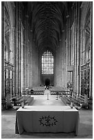 Altar, soaring arches of the Nave, and stained glass, Canterbury Cathedral. Canterbury,  Kent, England, United Kingdom ( black and white)