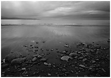Pebbles, beach, and Katchemak Bay. Homer, Alaska, USA ( black and white)