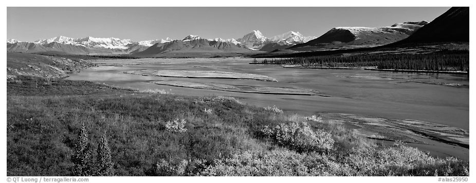 Tundra autumn scenery with wide river and mountains. Alaska, USA (black and white)