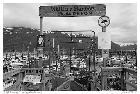 Ramp to harbor deck with Whittier sign. Whittier, Alaska, USA