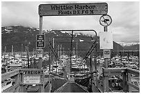 Ramp to harbor deck with Whittier sign. Whittier, Alaska, USA ( black and white)