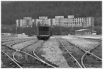 Rail tracks and Buckner building. Whittier, Alaska, USA ( black and white)