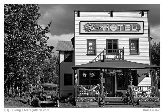 Small hotel with classic car parked by, afternoon. McCarthy, Alaska, USA (black and white)