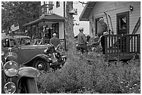Vintage cars and houses on main street. McCarthy, Alaska, USA (black and white)