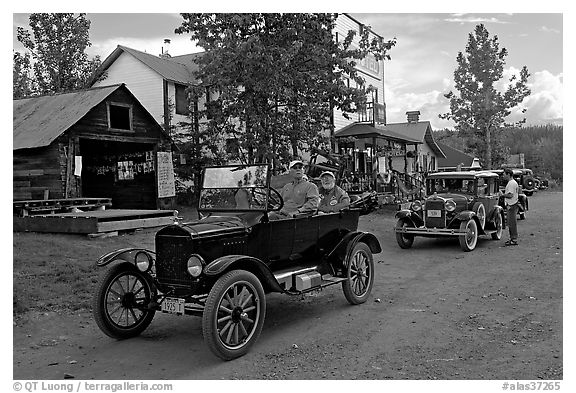 Classic cars driven on main street. McCarthy, Alaska, USA (black and white)
