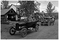 Classic cars driven on main street. McCarthy, Alaska, USA ( black and white)