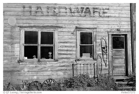 Windows and doors of old hardware store. McCarthy, Alaska, USA (black and white)