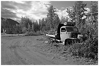 Side street with wrecked truck. McCarthy, Alaska, USA ( black and white)