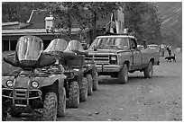 Four wheelers parked on main street. McCarthy, Alaska, USA ( black and white)