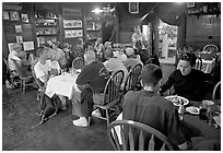 Dinner inside Mc Carthy lodge. McCarthy, Alaska, USA (black and white)