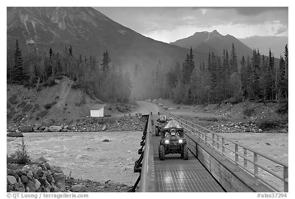 Four wheeler crossing the footbridge. McCarthy, Alaska, USA