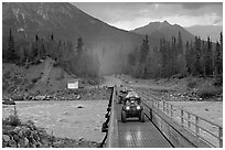 Four wheeler crossing the footbridge. McCarthy, Alaska, USA (black and white)