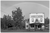Rainbow over the historic Ma Johnson hotel building. McCarthy, Alaska, USA (black and white)