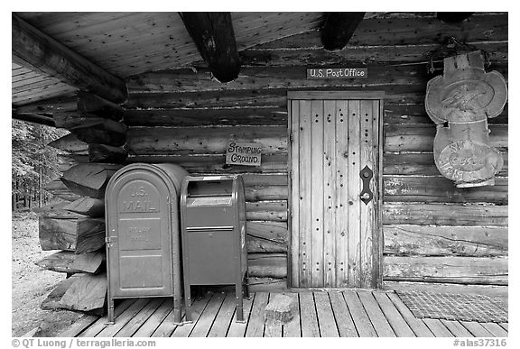 Mail boxes, log house post office, Slana. Alaska, USA