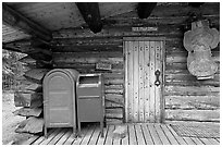 Mail boxes, log house post office, Slana. Alaska, USA ( black and white)