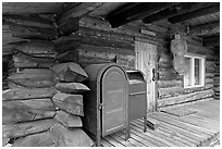 Mail boxes, log house postal office, Slana. Alaska, USA ( black and white)