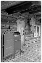 postal boxes, log house postal office, Slana. Alaska, USA ( black and white)