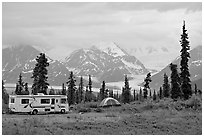 RV, tent, with glacier and mountains in background. Alaska, USA (black and white)