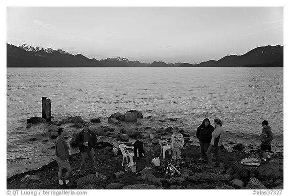Families pickniking with fire, Resurrection Bay, sunset. Seward, Alaska, USA
