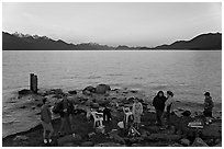 Families pickniking with fire, Resurrection Bay, sunset. Seward, Alaska, USA ( black and white)