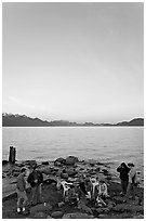 Family enjoying midnight picknik, Resurrection Bay, sunset. Seward, Alaska, USA (black and white)