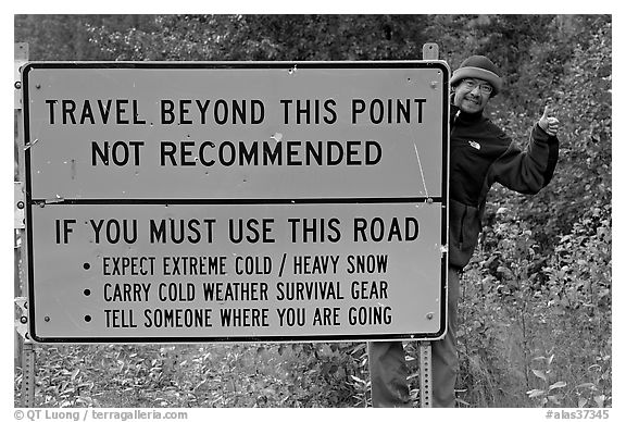 Sign with warnings about winter travel, Exit Glacier Road. Seward, Alaska, USA (black and white)