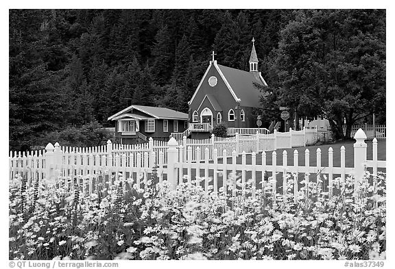 Flowers, white picket fence and church. Seward, Alaska, USA (black and white)