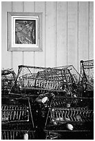 Fishing baskets and wall. Kotzebue, North Western Alaska, USA (black and white)
