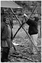 Inupiaq Eskimo women drying fish, Ambler. North Western Alaska, USA ( black and white)