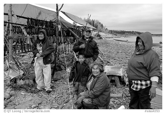 Inupiaq Eskimo family with stand of drying fish, Ambler. North Western Alaska, USA (black and white)