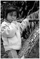 Inupiaq Eskimo girl near drying fish, Ambler. North Western Alaska, USA (black and white)