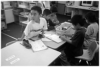 Inupiaq Eskimo kids in the classroom. Note names on table. Kiana. North Western Alaska, USA ( black and white)