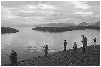 Fishing for salmon in the Spit's Fishing Hole. Homer, Alaska, USA ( black and white)