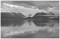 Kenai Mountains reflected in Katchemak Bay. Homer, Alaska, USA ( black and white)