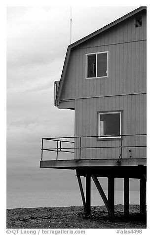 House on stilts on the Spit. Homer, Alaska, USA (black and white)