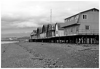 Beach and stilt houses on the Spit. Homer, Alaska, USA (black and white)
